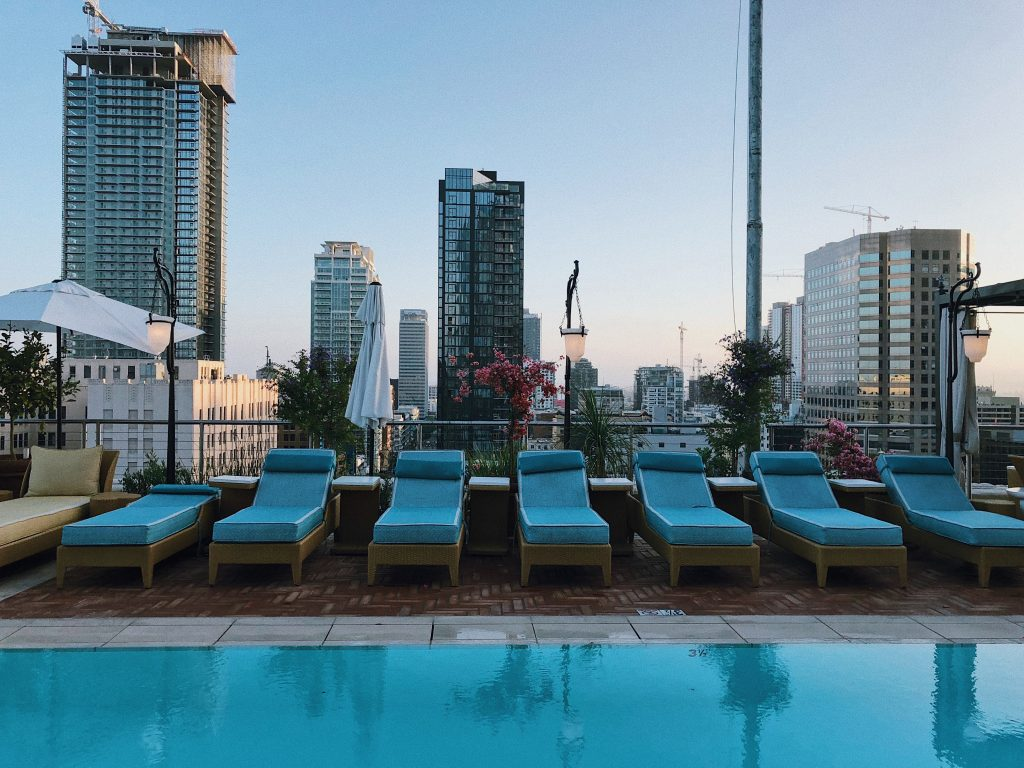 rooftop pool at the nomad hotel with a view of los angeles