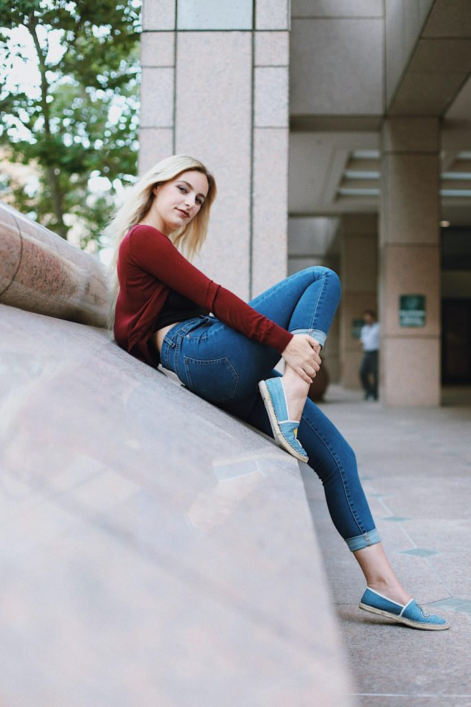 fashionable young woman posing in casual clothing
